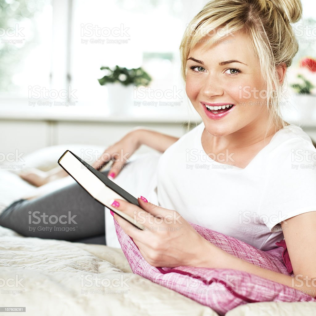 Happy woman holding a book stock photo