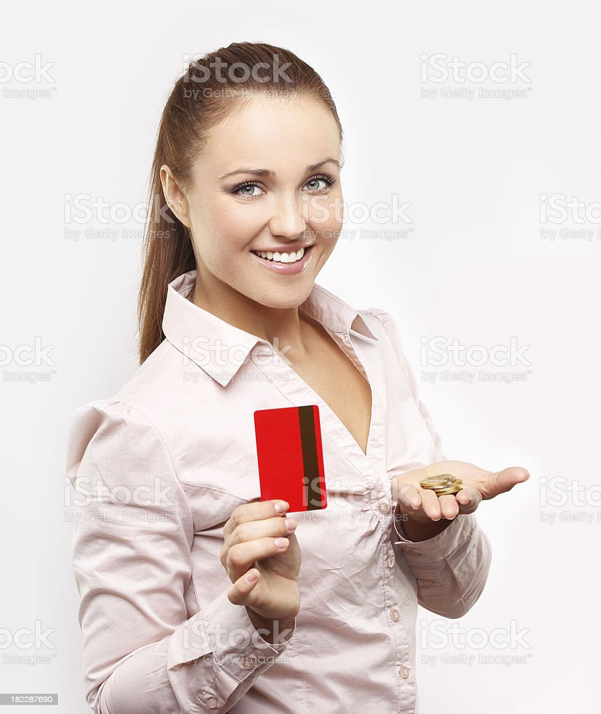 Happy woman holding a money and credit card. royalty-free stock photo