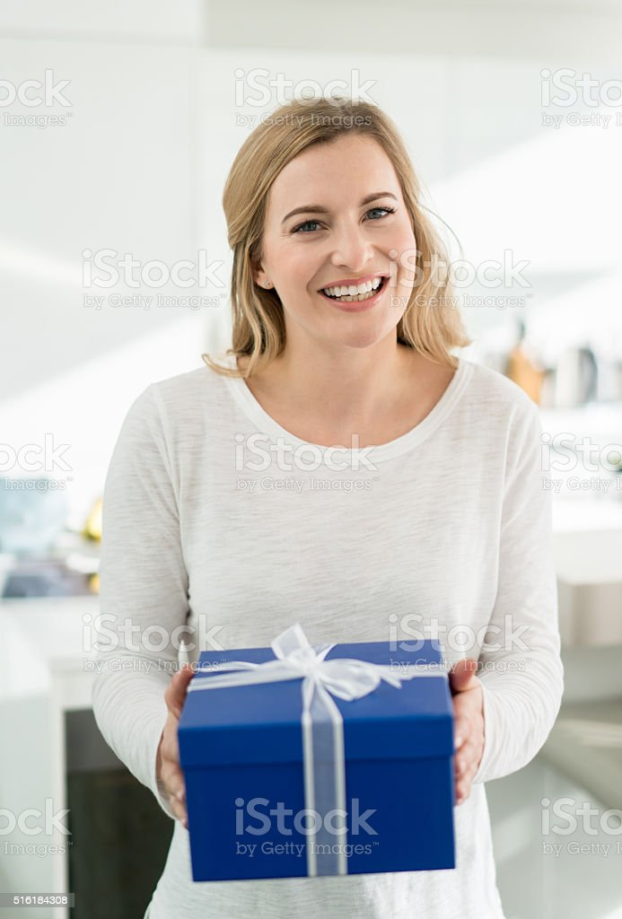 Happy woman holding a present stock photo