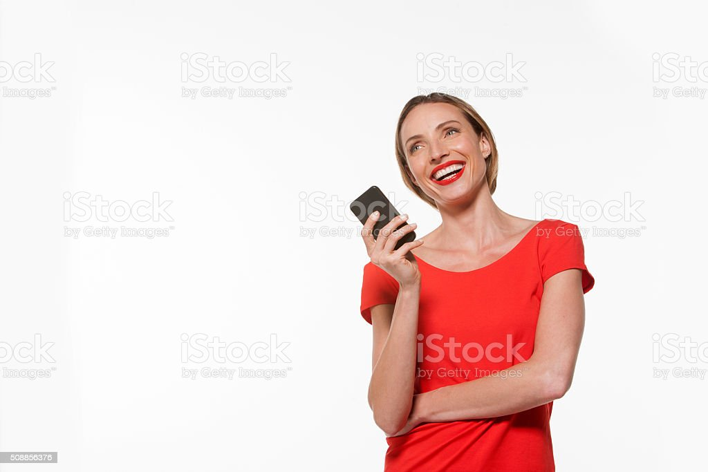 Happy woman holding a smart phone stock photo