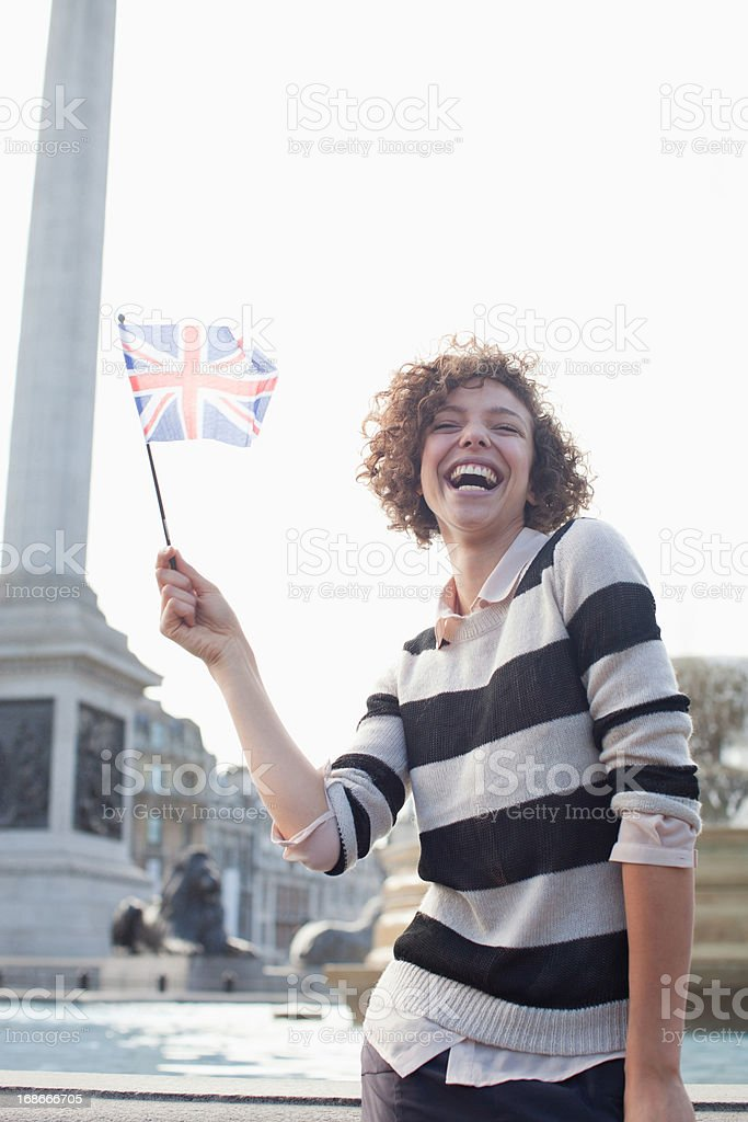 Happy woman holding British flag royalty-free stock photo
