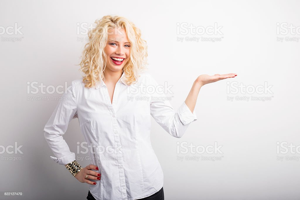 Happy woman holding her hand extended stock photo