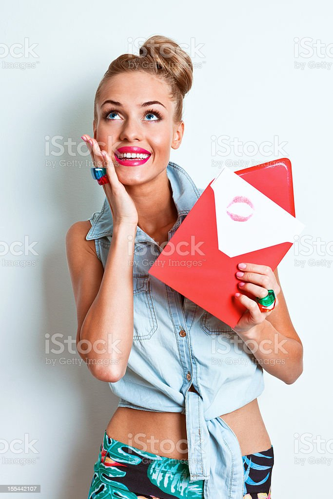 Happy woman holding love letter stock photo