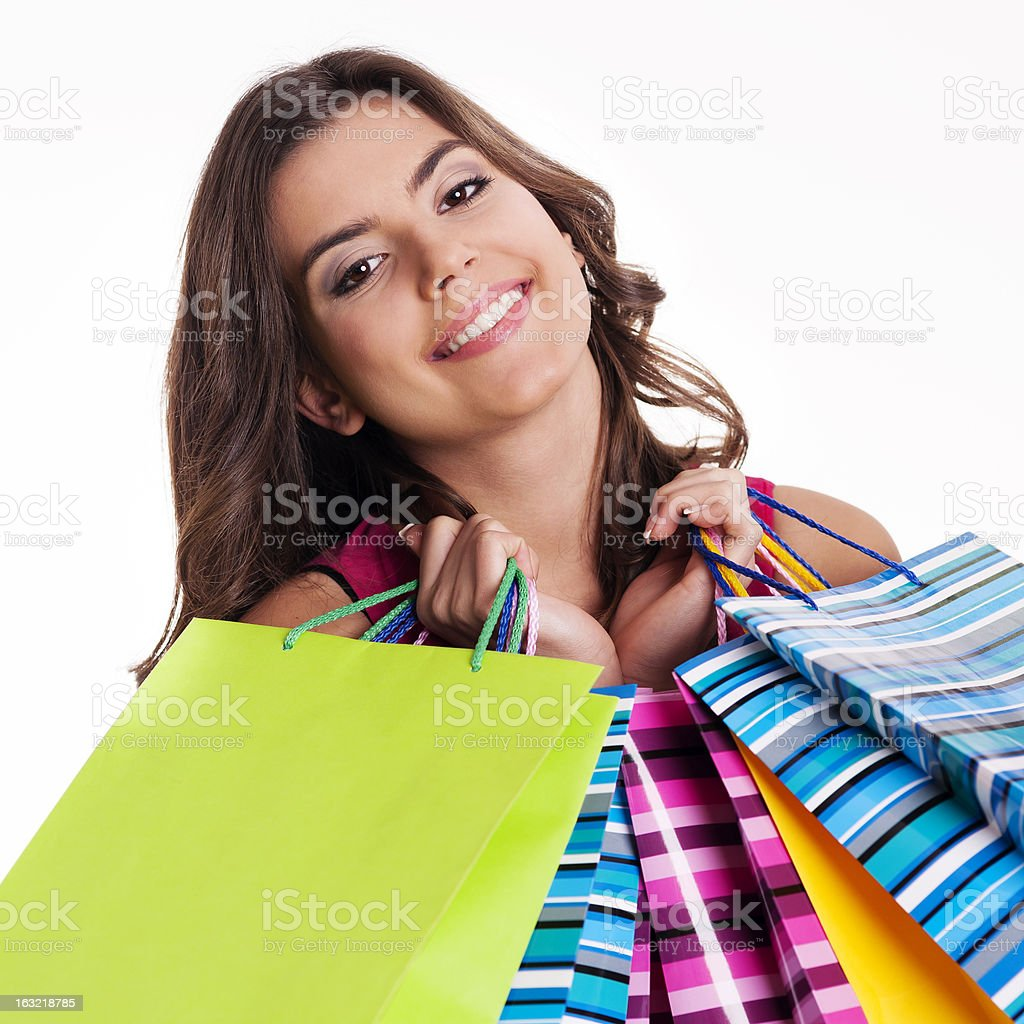 Happy woman holding multi colored shopping bags royalty-free stock photo
