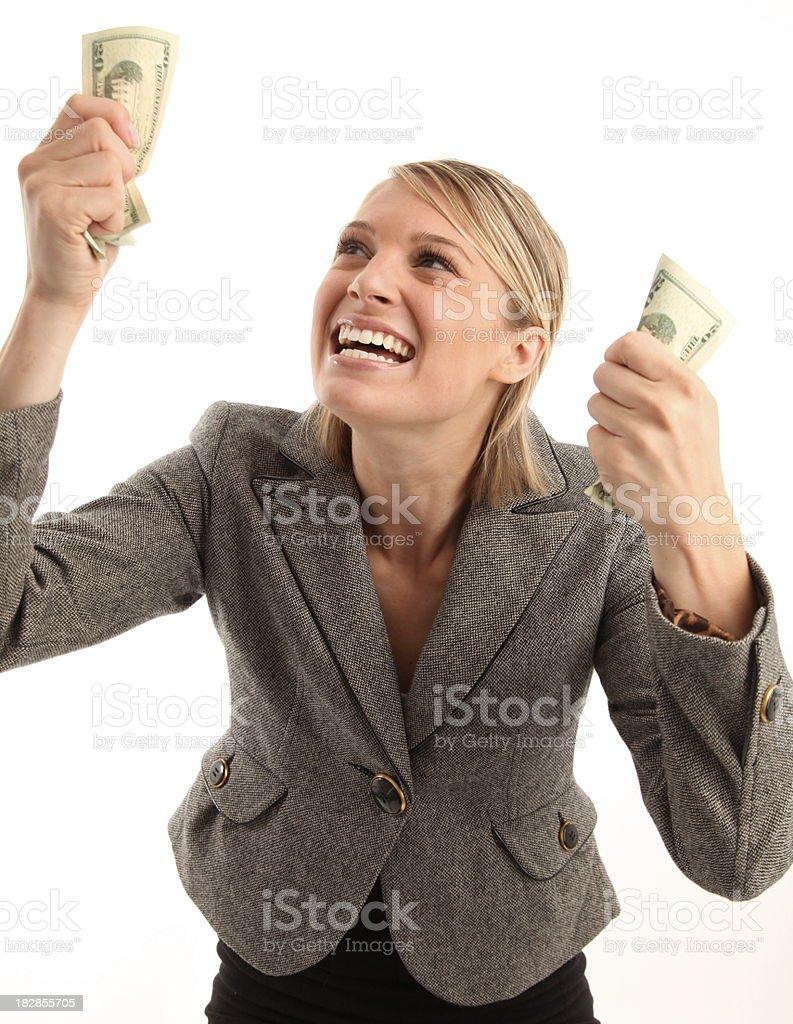 Feliz mujer agarrando en hermético a su dinero foto de stock libre de derechos
