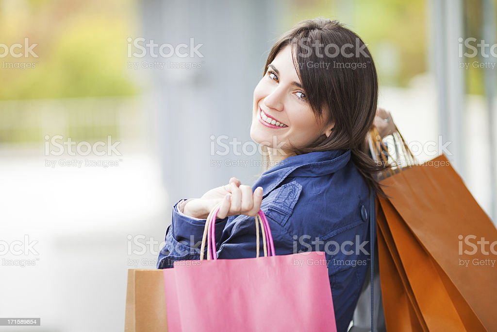 Happy woman holding shopping bags royalty-free stock photo