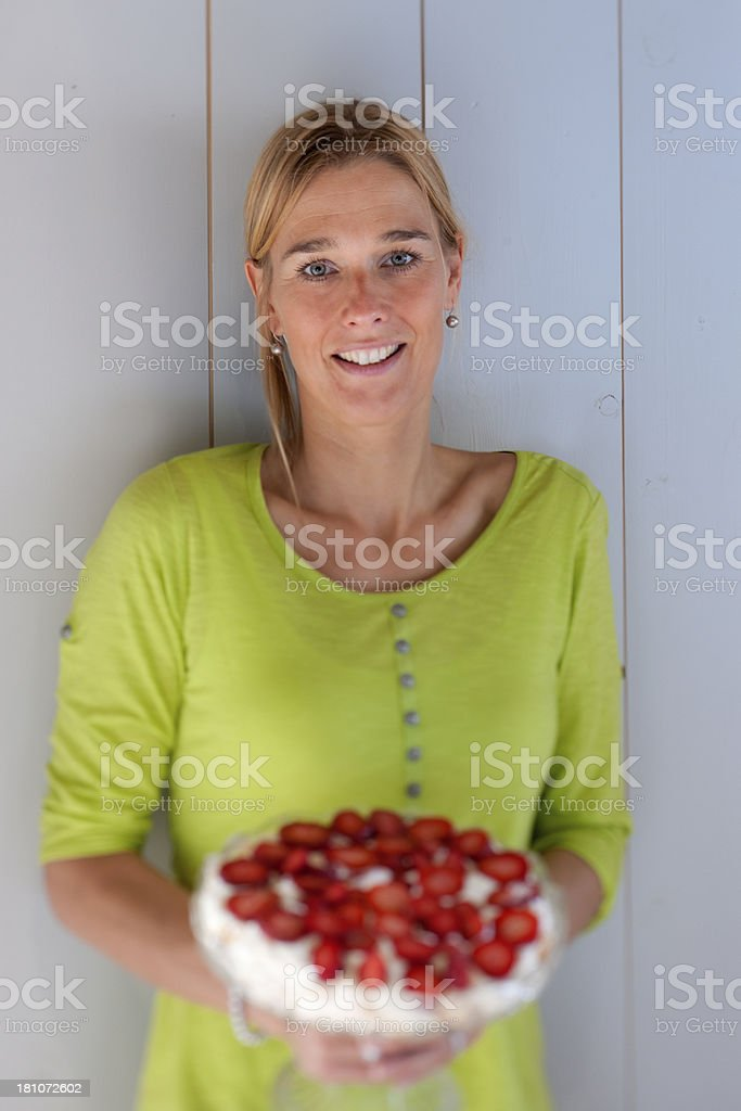 happy woman holding strawberry cheesecake royalty-free stock photo