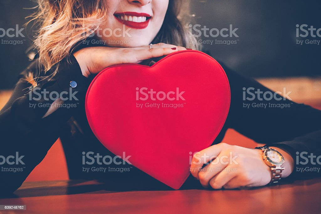 Happy Woman Holding Valentine's Day Gift stock photo