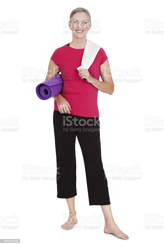 Happy woman holding yoga mat and towel, isolated on white royalty-free stock photo