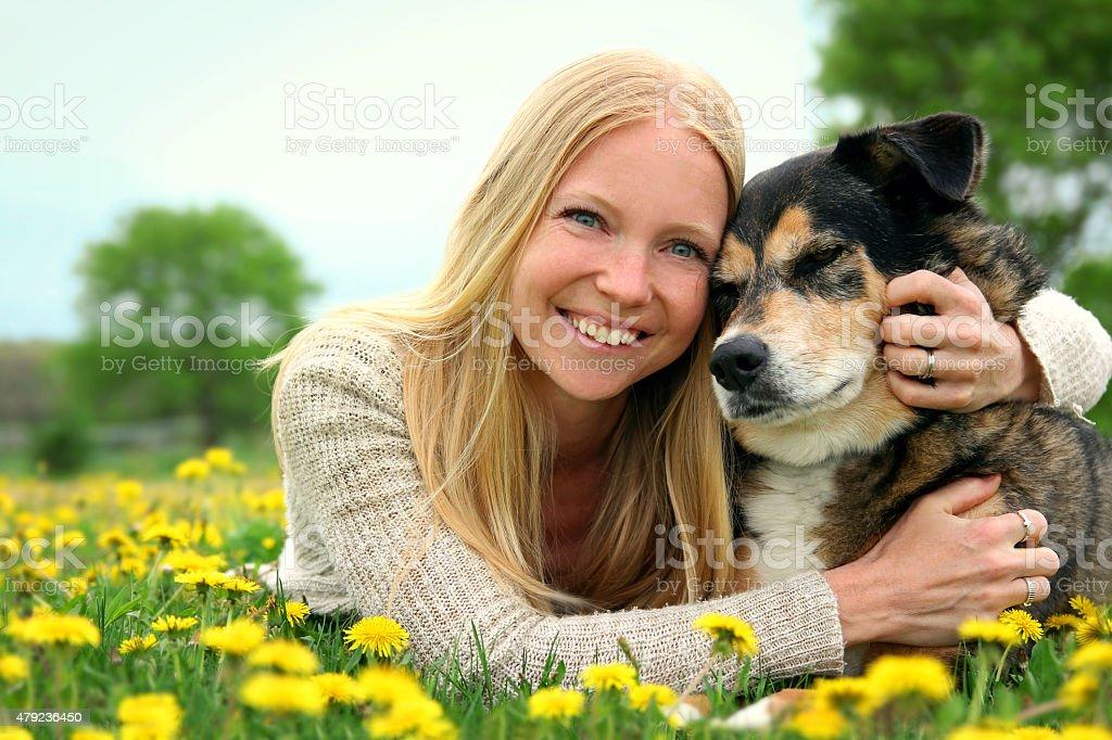 Happy Woman Hugging German Shepherd Dog stock photo
