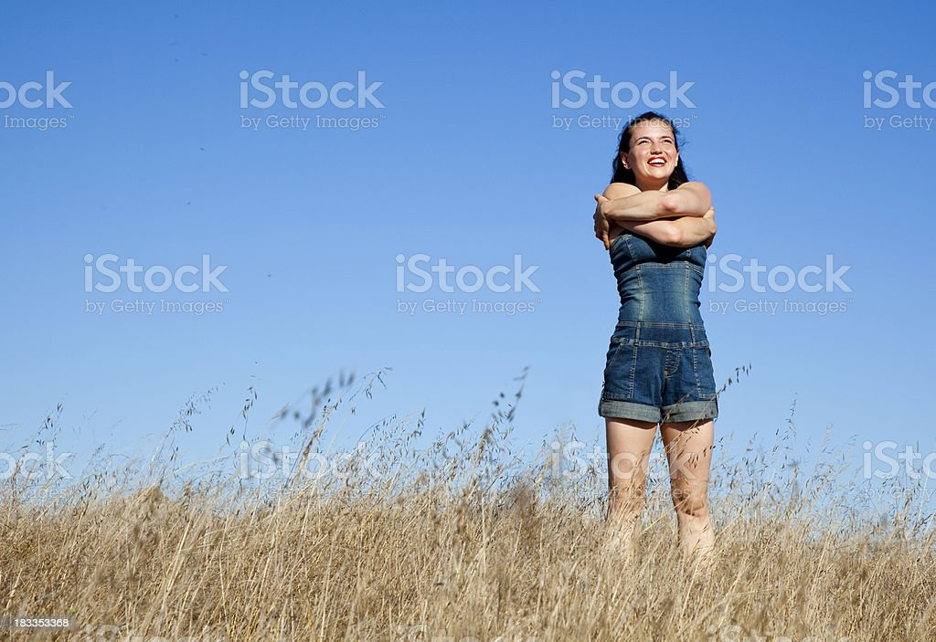 happy woman hugging herself - copy space stock photo