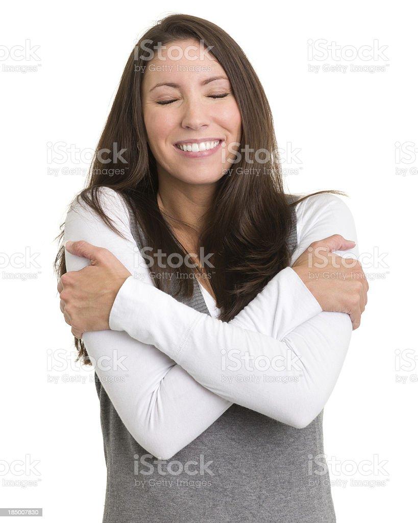 Happy Woman Hugging Herself stock photo