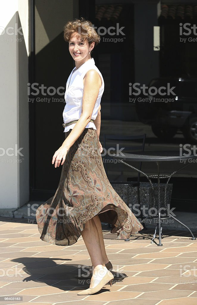 Happy woman in a city royalty-free stock photo
