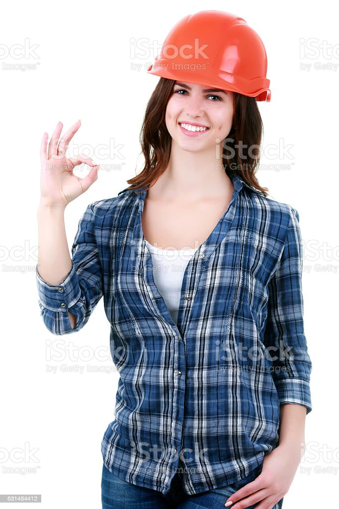 Happy woman in builder uniform stock photo