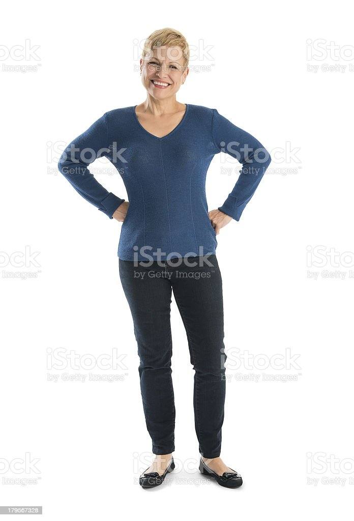 Happy Woman In Casuals Standing With Hands On Hips stock photo