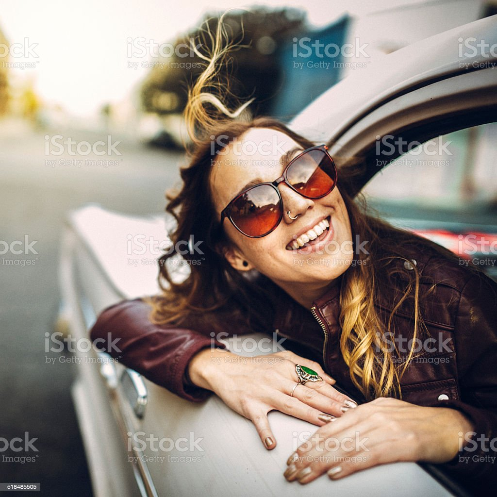 Happy Woman in Classic Car stock photo