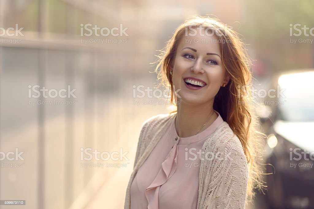 Happy woman in early morning sunlight stock photo