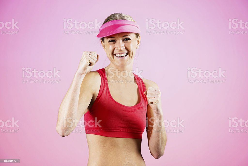 Happy woman in fighting pose royalty-free stock photo