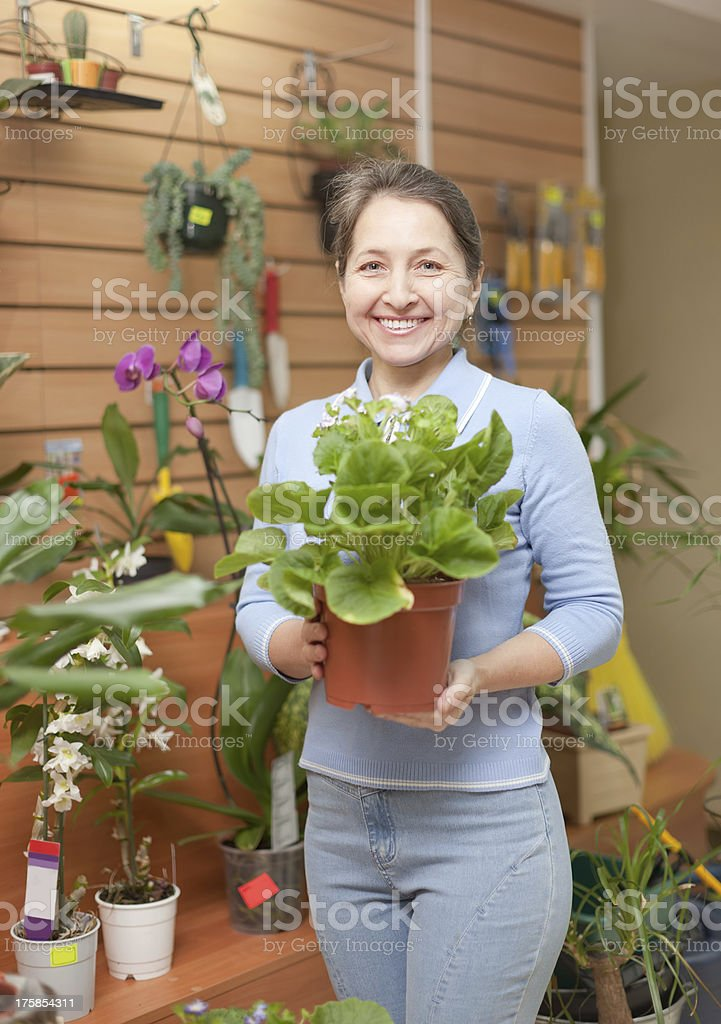 Happy  woman in floral store stock photo