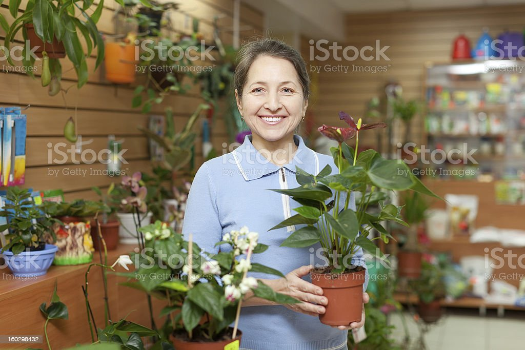 Happy  woman  in flower store stock photo