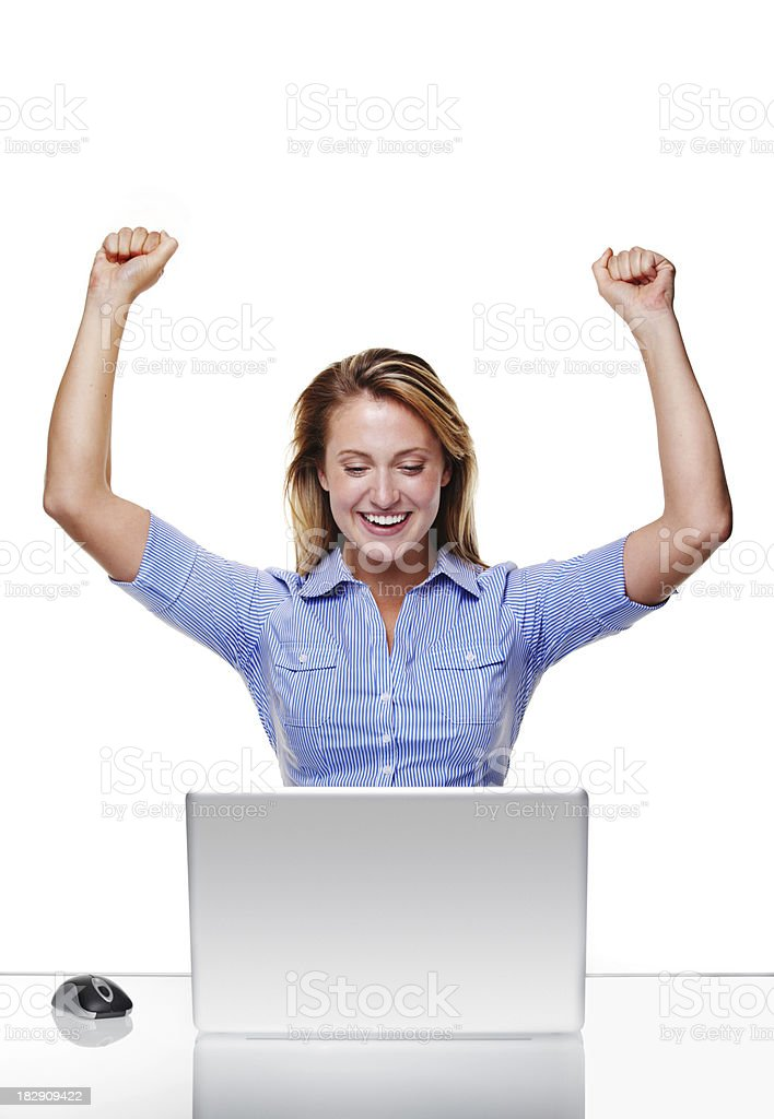 Happy woman in front of laptop isolated on white royalty-free stock photo