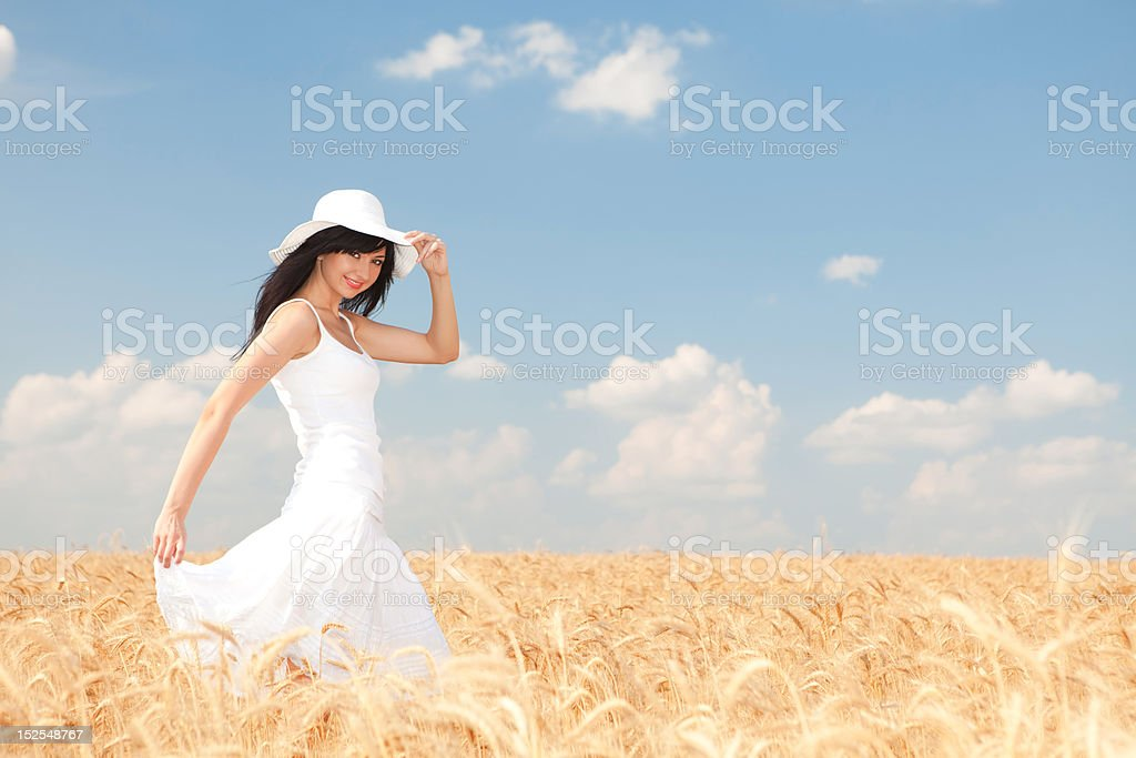 Happy woman in golden wheat royalty-free stock photo