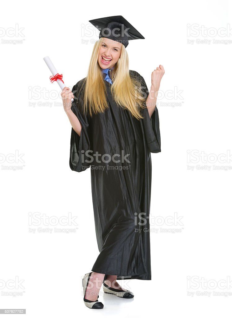 Happy woman in graduation gown with diploma rejoicing success stock photo
