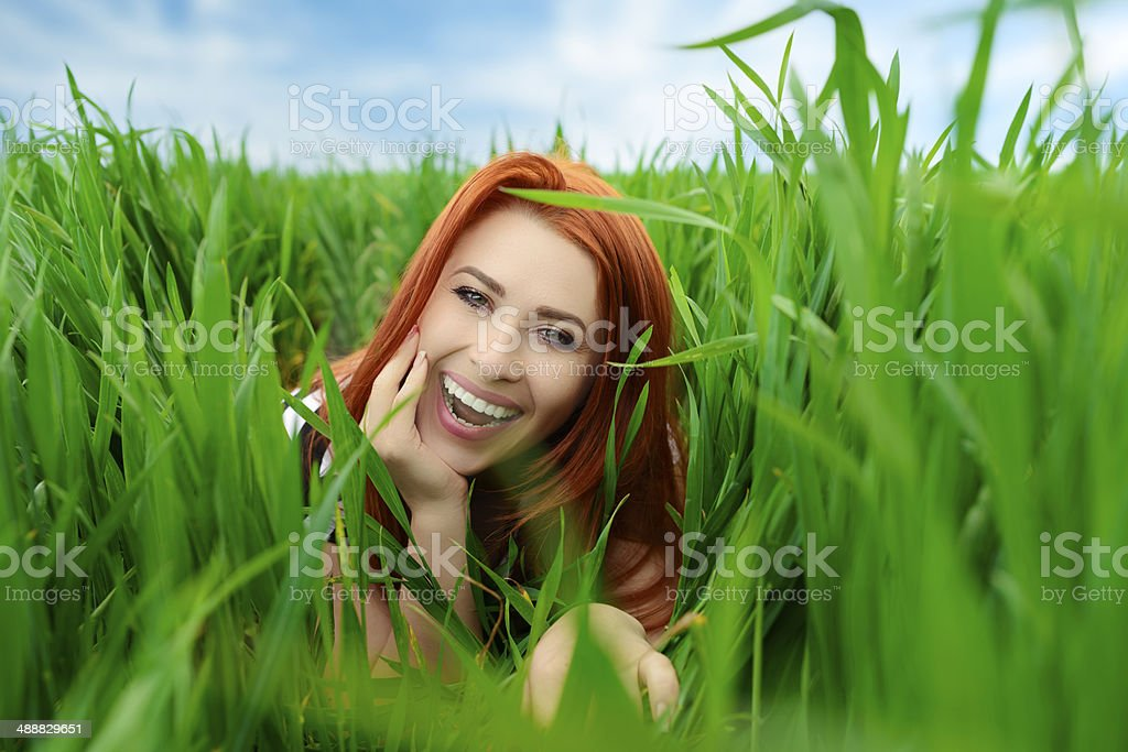 happy woman in grass royalty-free stock photo