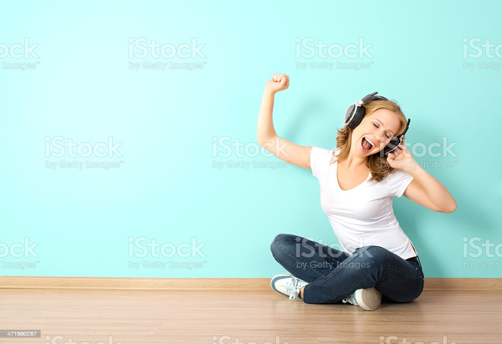 happy  woman in headphones listening to music royalty-free stock photo