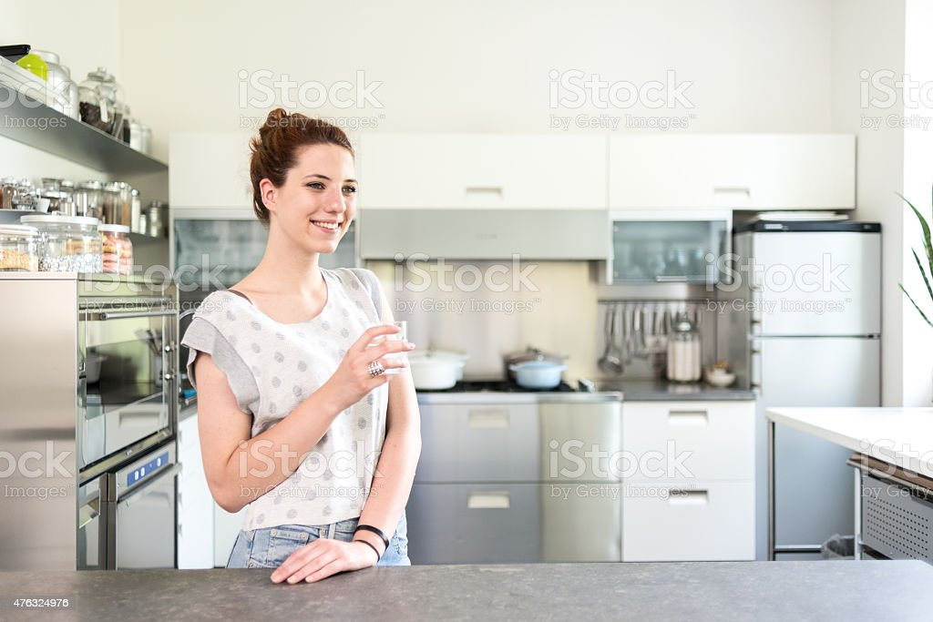 Happy woman in her new kitchen stock photo