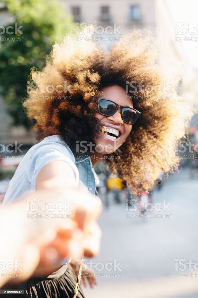 Happy woman in love dancing with friend stock photo