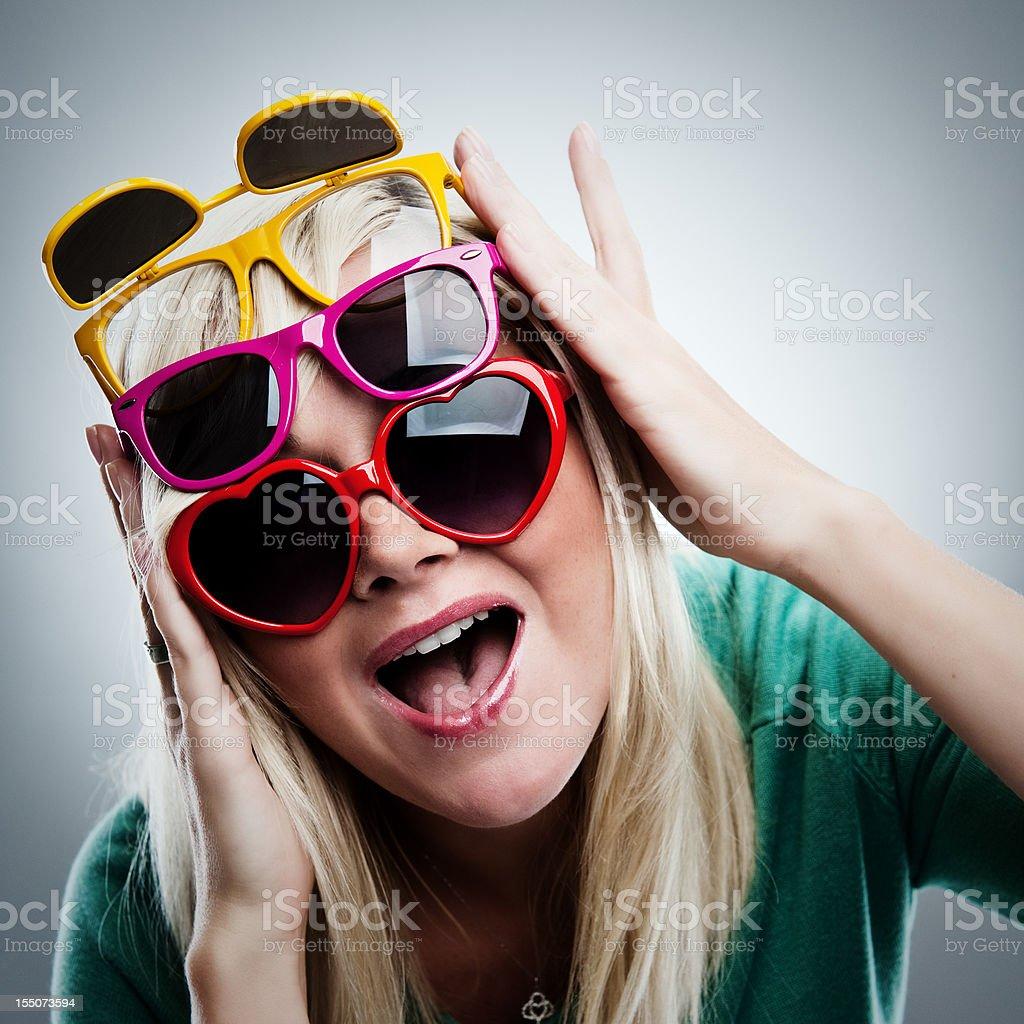Happy woman in many sunglasses royalty-free stock photo
