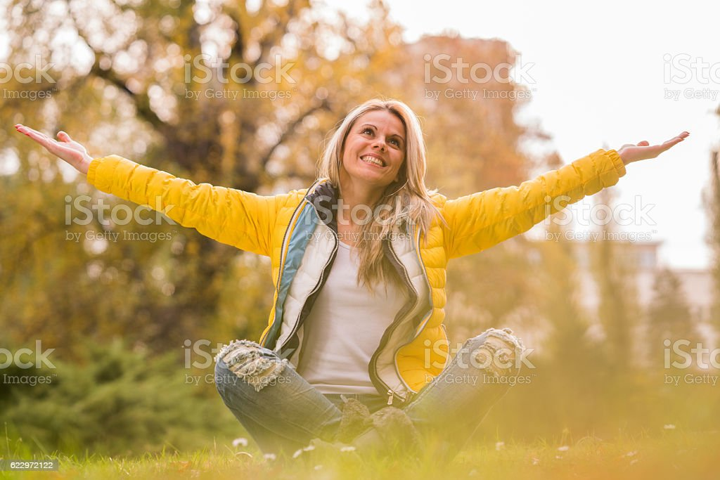 Happy woman in nature stock photo