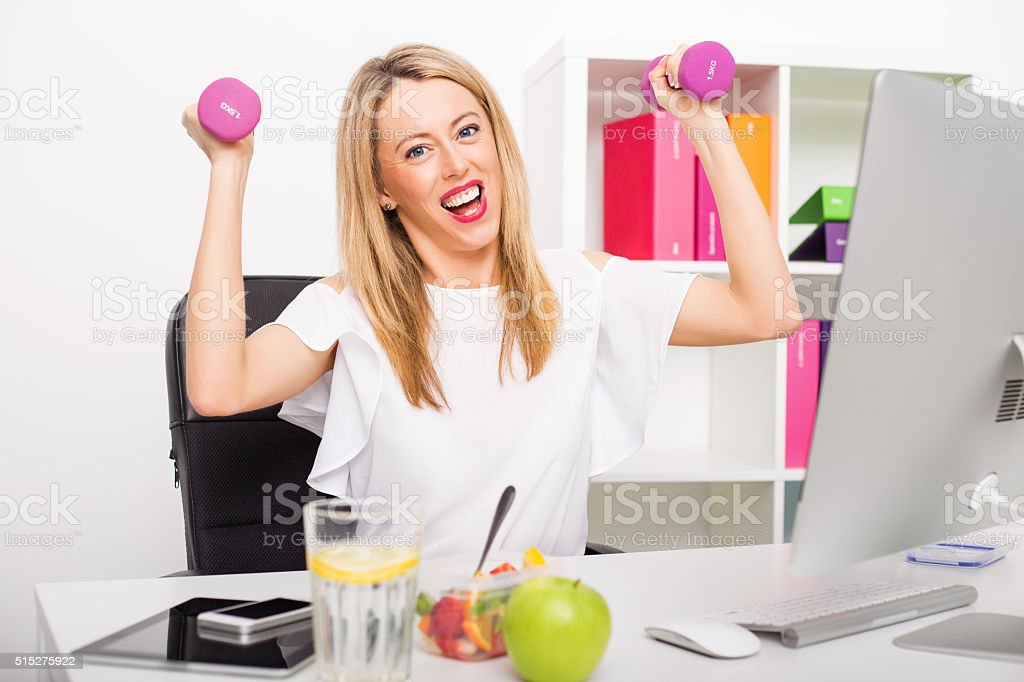 Happy woman in office being active stock photo