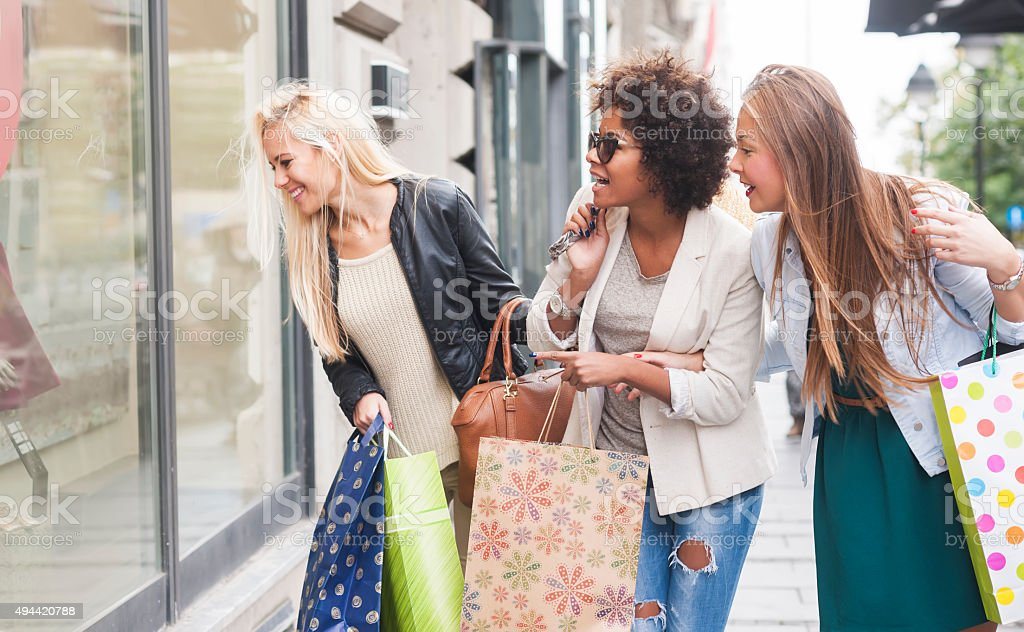 Happy woman in shopping stock photo
