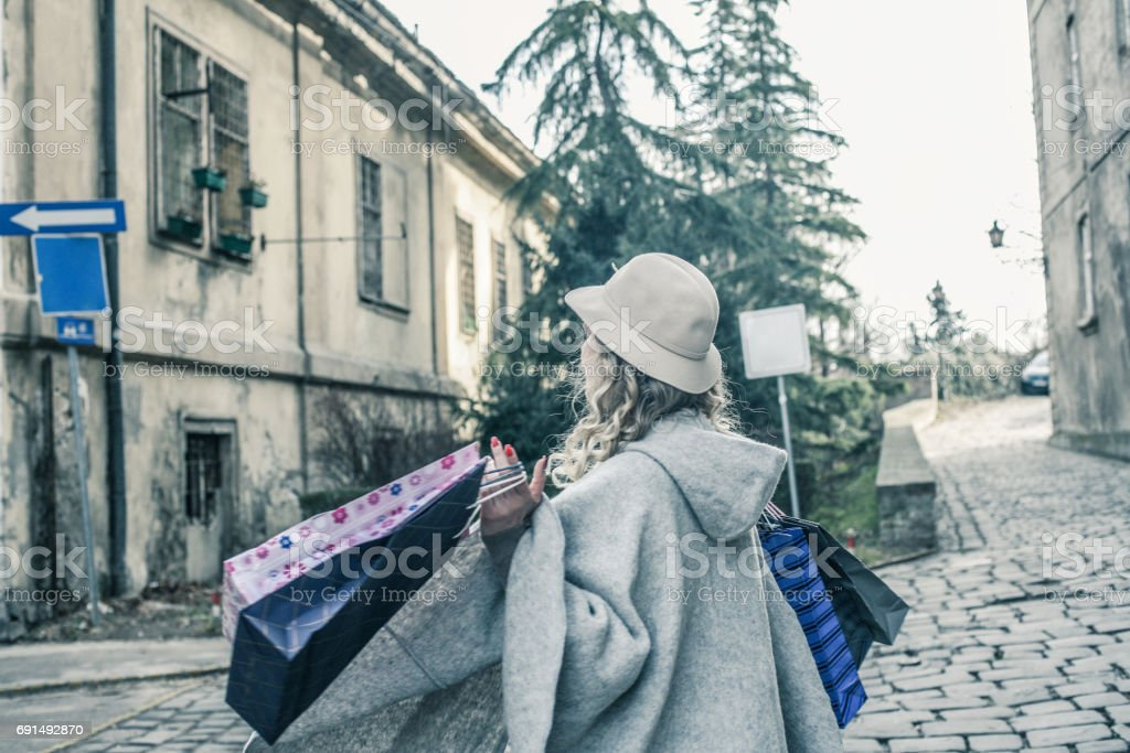 Happy woman in shopping. Young woman happy shopping street. From...