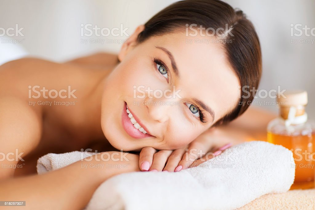 happy woman in spa salon stock photo