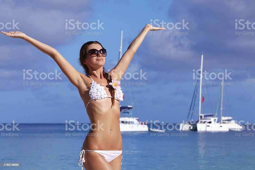 Happy woman in sunglasses on the beach royalty-free stock photo