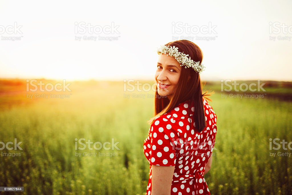 Happy woman in the meadow stock photo