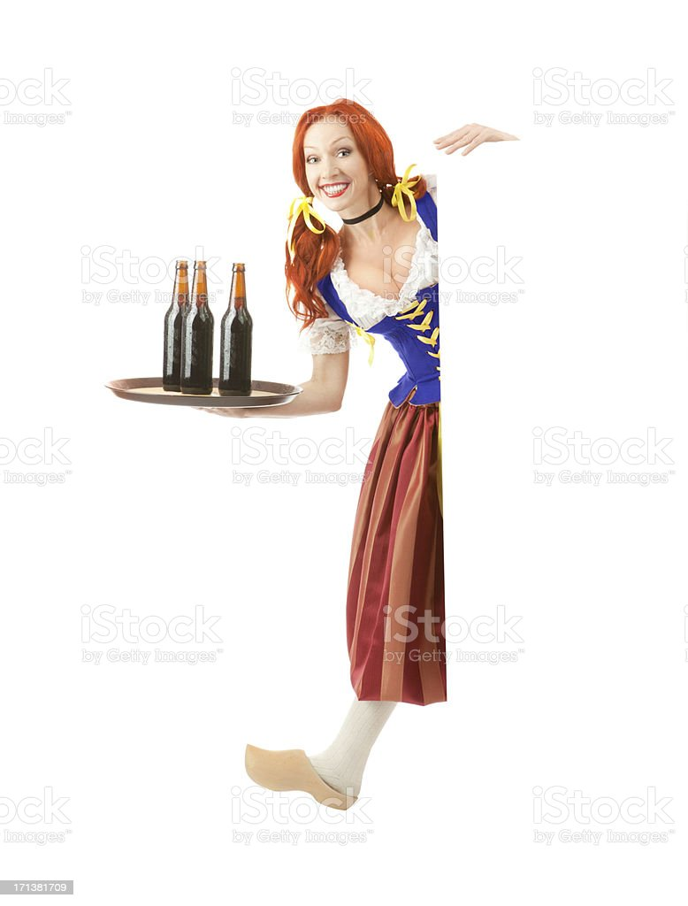 Happy Woman in Traditional Costume with Beer. stock photo