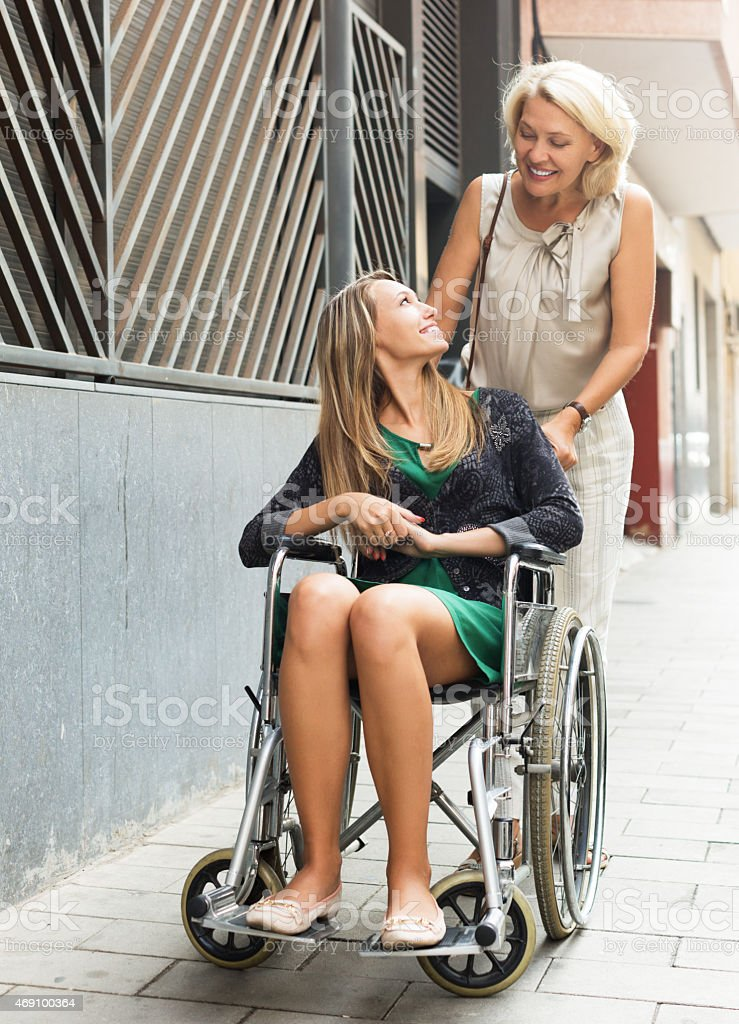 Happy woman in wheelchair  outdoor stock photo