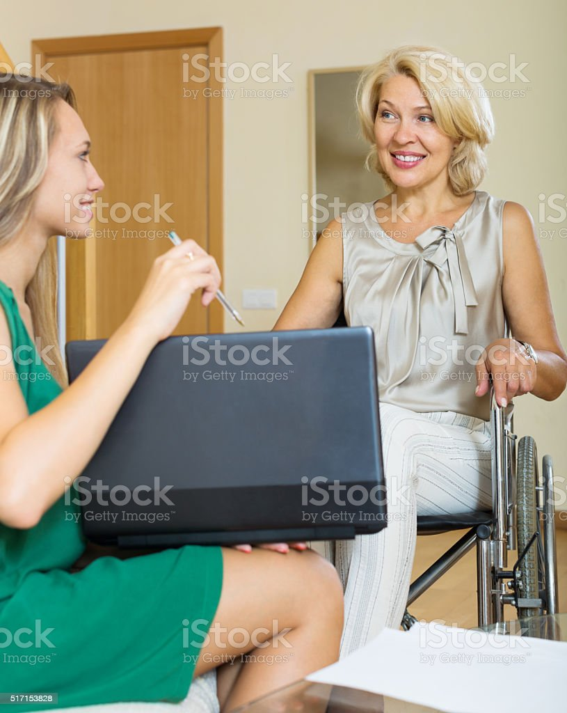 Happy woman in wheelchair stock photo