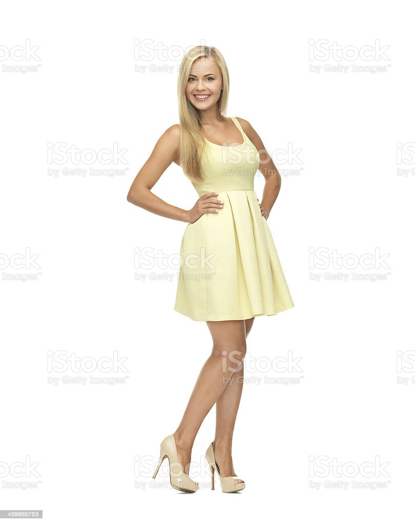 happy woman in yellow summer dress stock photo