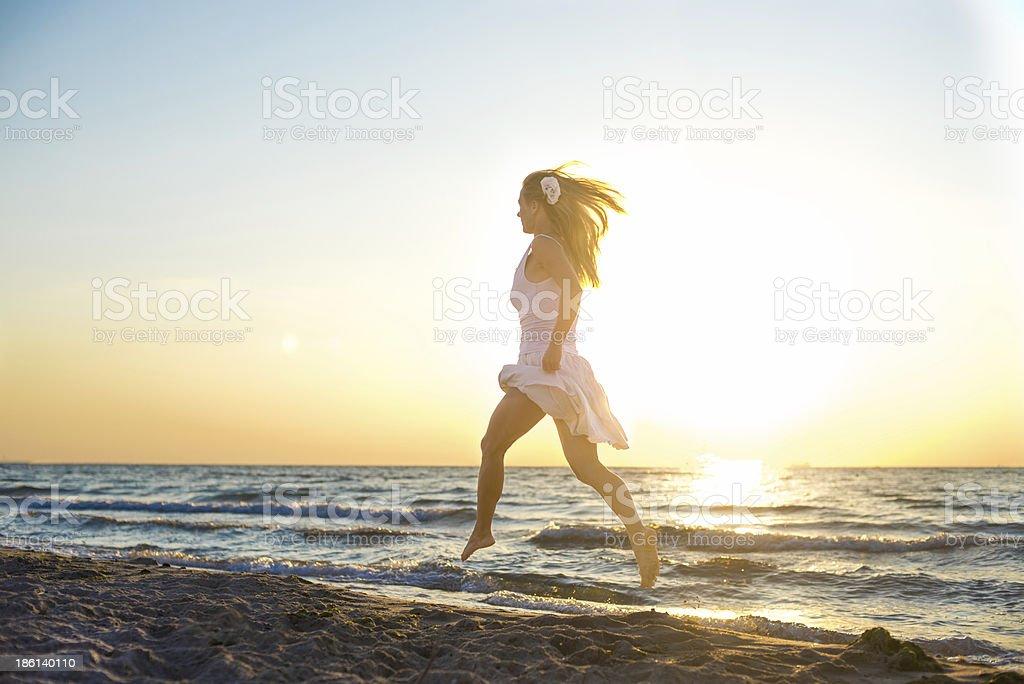 Happy Woman Jumping at the sea royalty-free stock photo