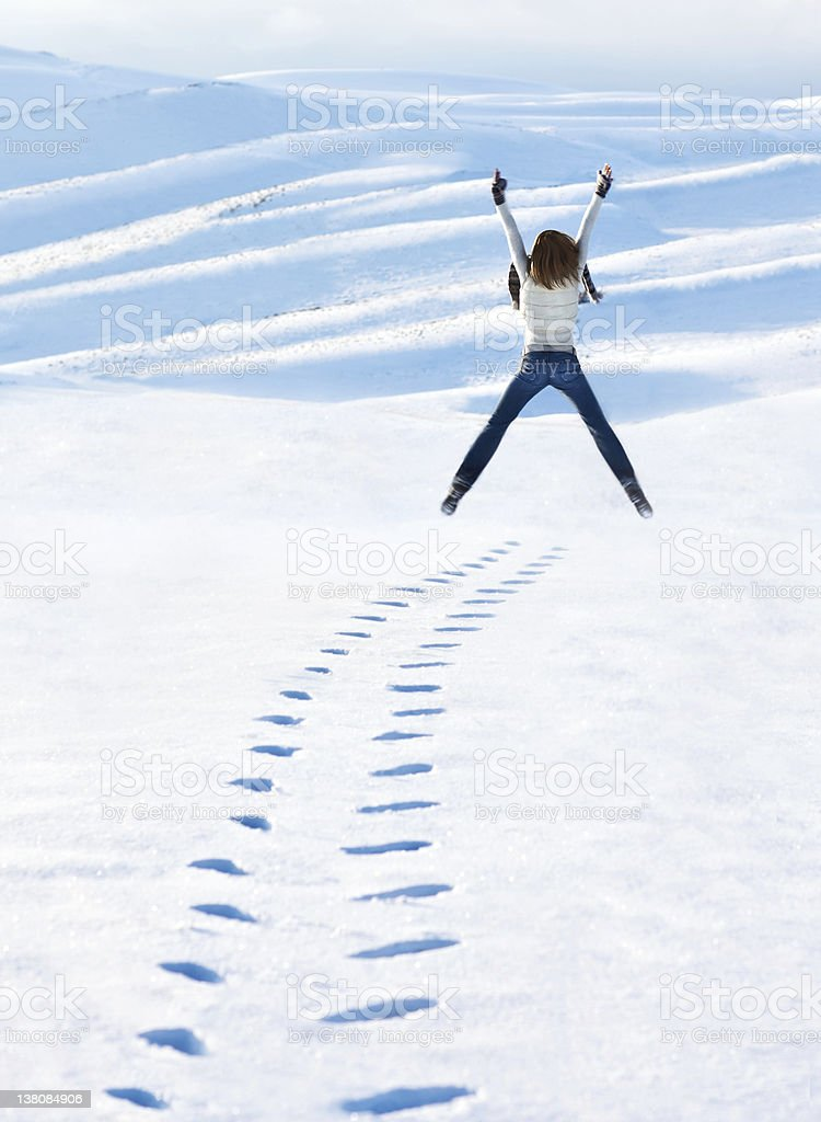Happy woman jumping at winter mountains royalty-free stock photo