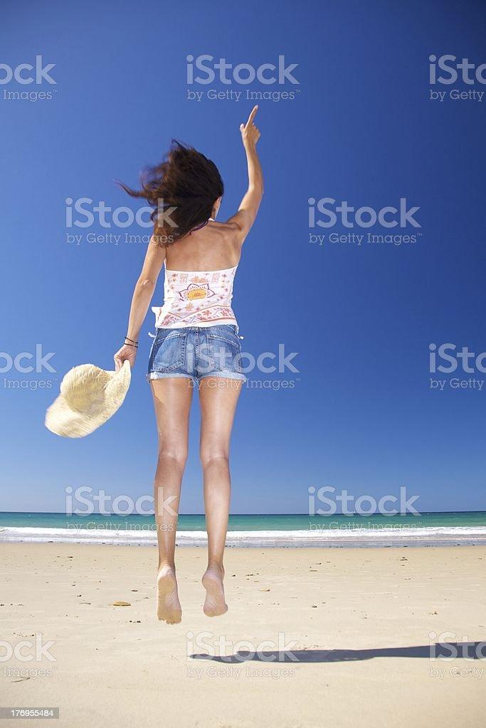 happy woman jumping at Zahara beach royalty-free stock photo