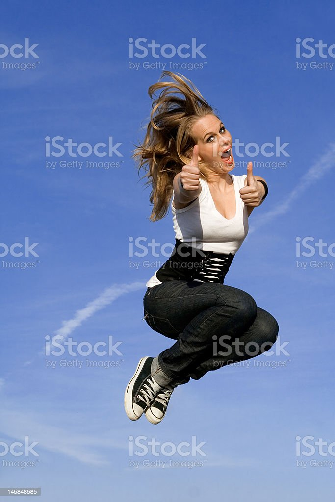 happy woman jumping for joy royalty-free stock photo
