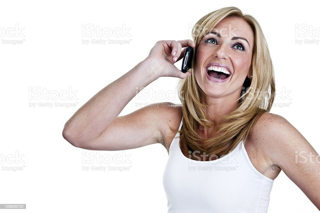 Happy woman laughing while on phone royalty-free stock photo