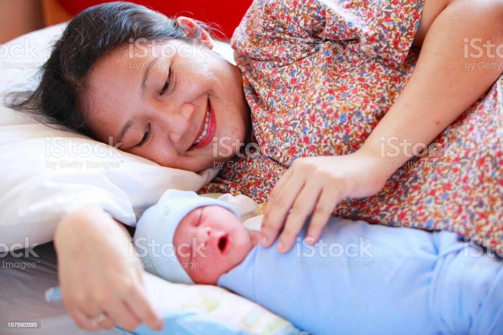 happy woman looking at her bewborn baby royalty-free stock photo
