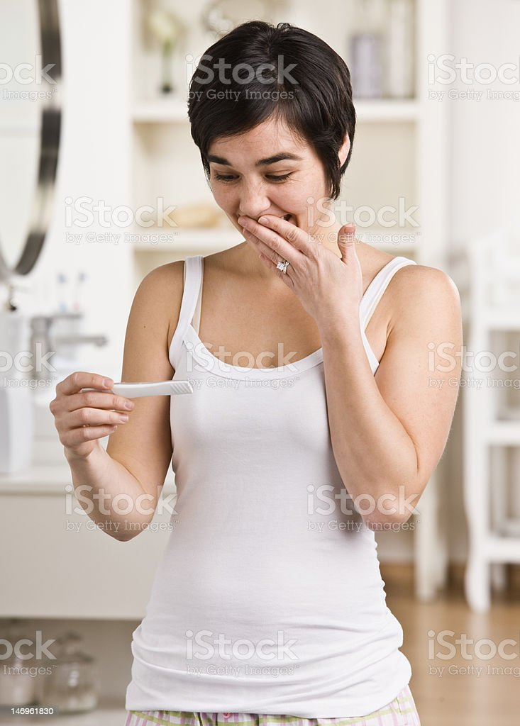 Happy Woman looking at Pregnancy Test royalty-free stock photo